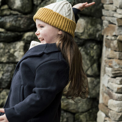 Children's Yellow And Cream Woollen Knitted Hat With Blue Pompom